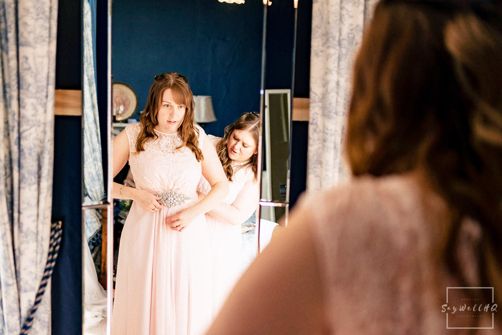 Prestwold Hall Wedding Photography - bride and bridesmaids getting ready on the morning of the brides wedding