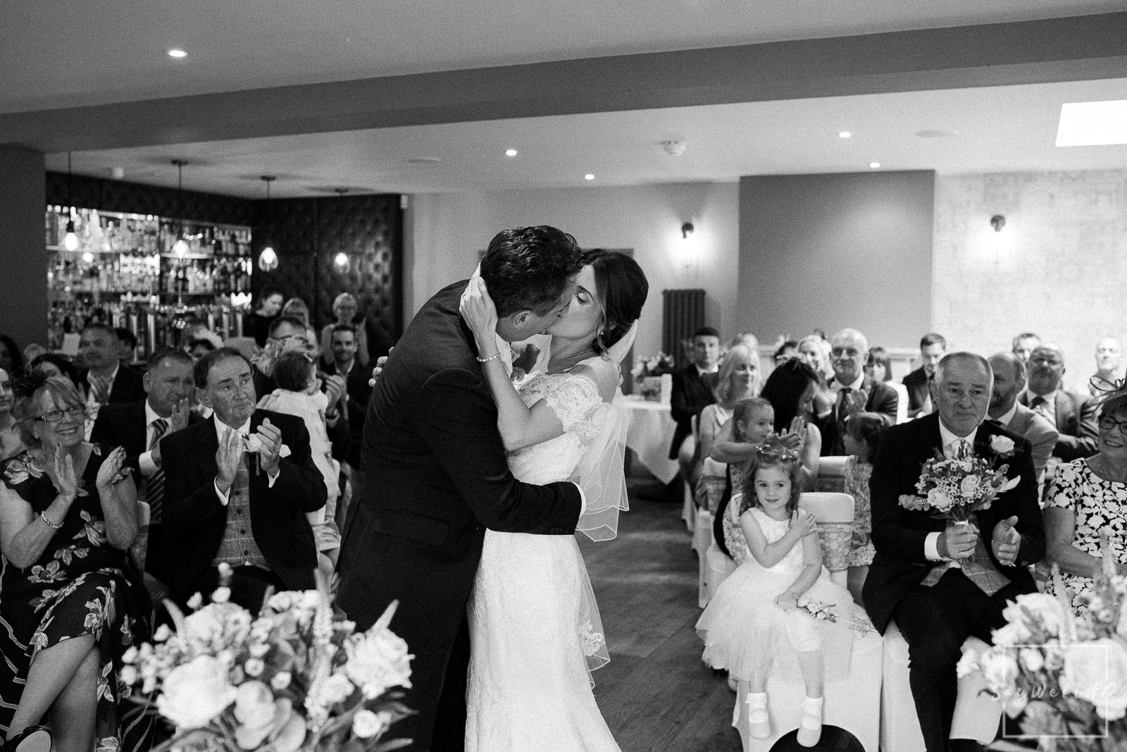 The Chequers Inn Wedding Photography - Bride and groom enjoy the wedding ceremony