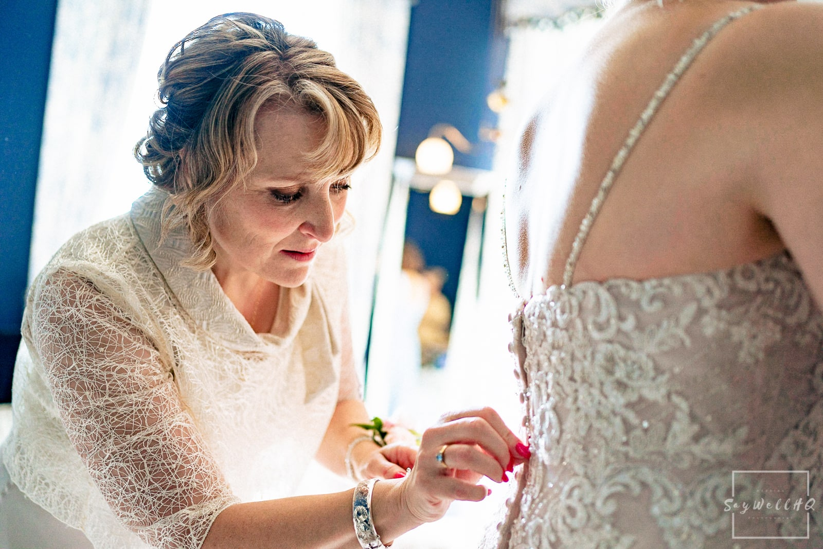 Prestwold Hall Wedding Photography - Bride getting in and wearing her wedding dress