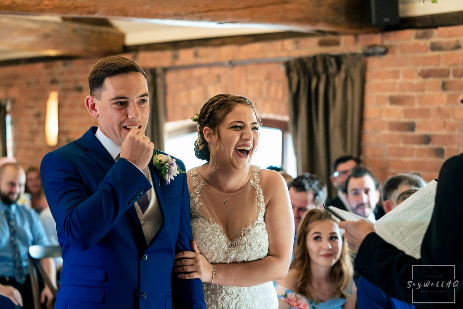 Swancar Farm Wedding Photography - Bride and groom enjoy the wedding ceremony at swancar Farm in Nottingham