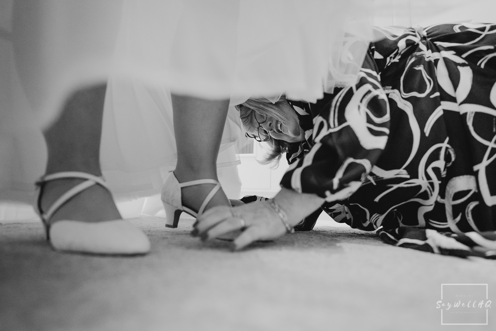 St Judes Church Mapperley Wedding Photography - Bride gets some help from her Mum in getting her wedding shoes on