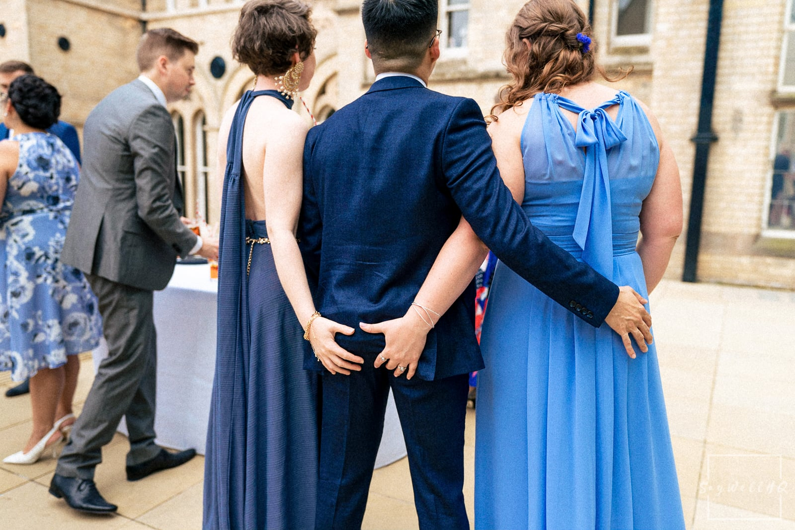 Nottingham Wedding Photography - Same sex wedding photography Nottingham - wedding guests enjoy the after ceremony drinks and games