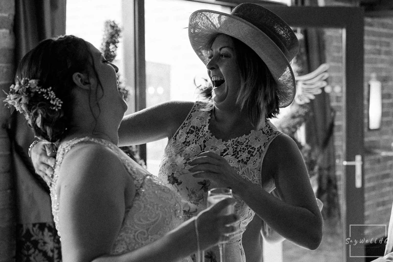 Swancar Farm Wedding Photography - wedding guests enjoy the post wedding ceremony drinks and sunshine