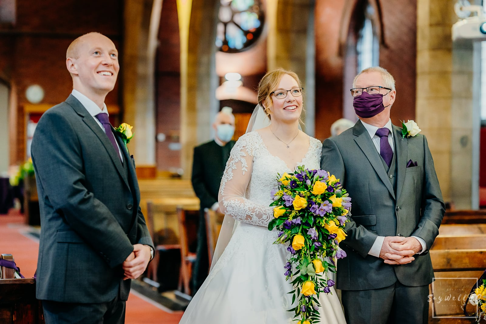 St Judes Church Mapperley Wedding Photography - Bride and Groom watching a slideshow of their photos before the wedding ceremony