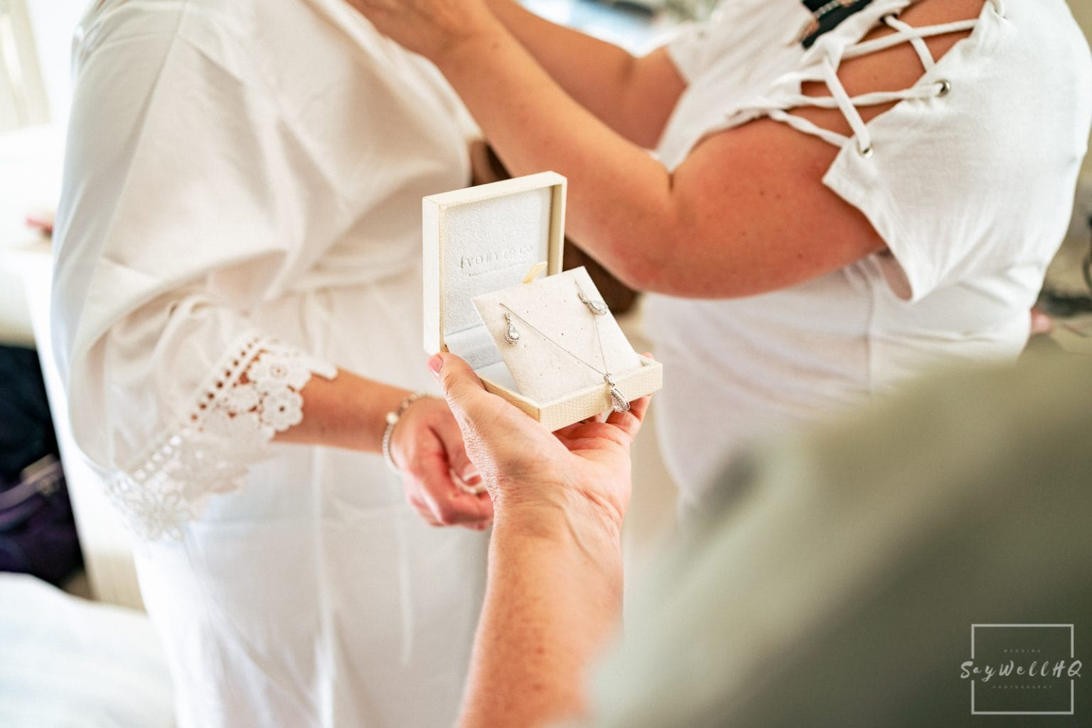 Winstanley House Wedding Photography - Bride and Bridesmaids getting ready before the summer wedding