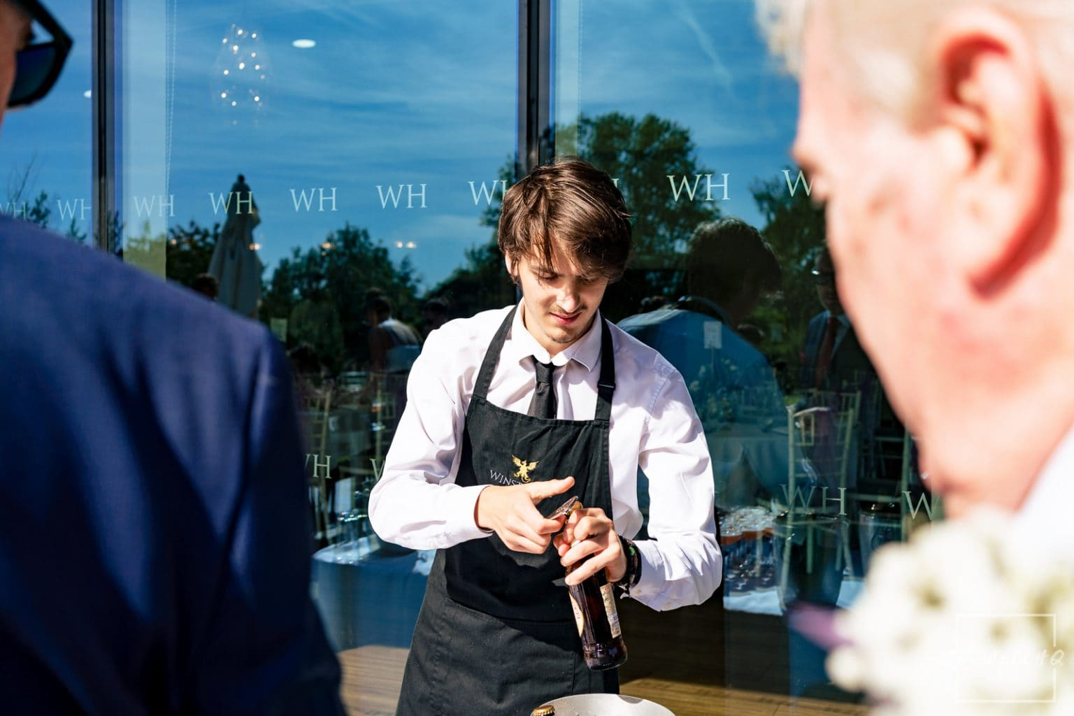 Winstanley House Wedding Photography - wedding guests enjoy the post wedding ceremony drinks and summer sun