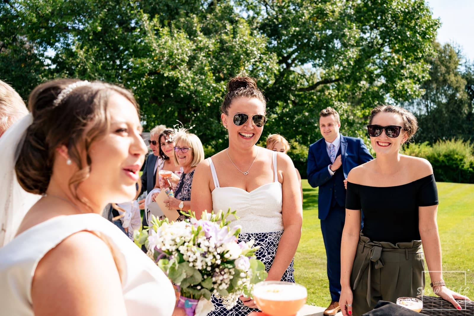 Winstanley House Wedding Photography - Bride and Groom meet their wedding guests following their outdoor wedding ceremony