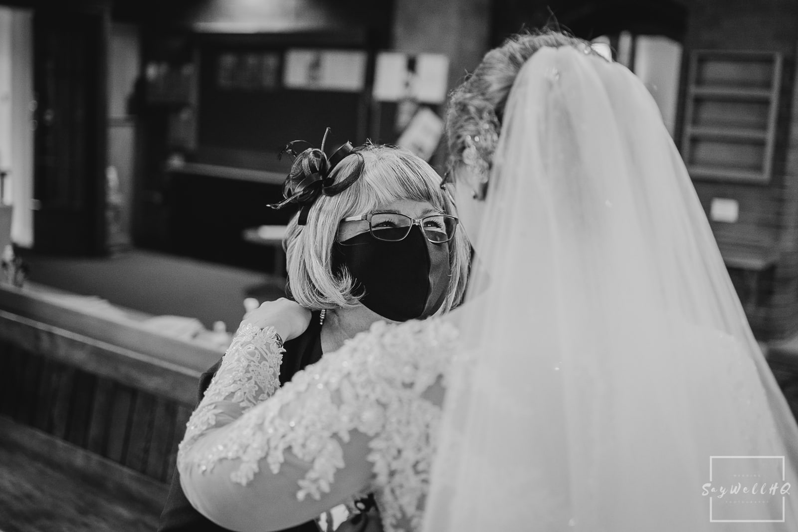 St Judes Church Mapperley Wedding Photography - Bride embracing in emotional hugs following the Church wedding ceremony