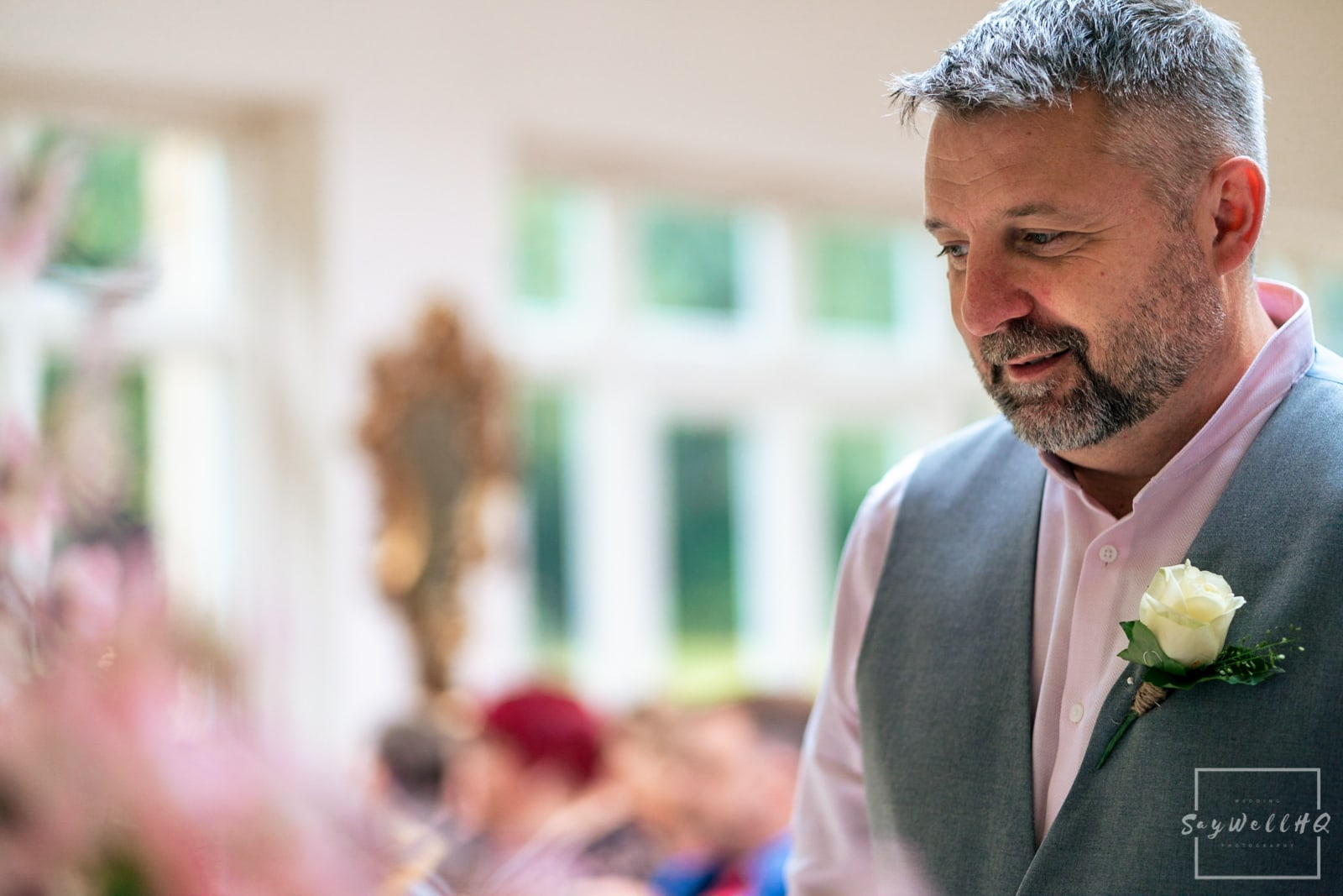 Woodborough Hall Wedding Photography - Groom looking nervous waiting for his bride to come down the wedding aisle