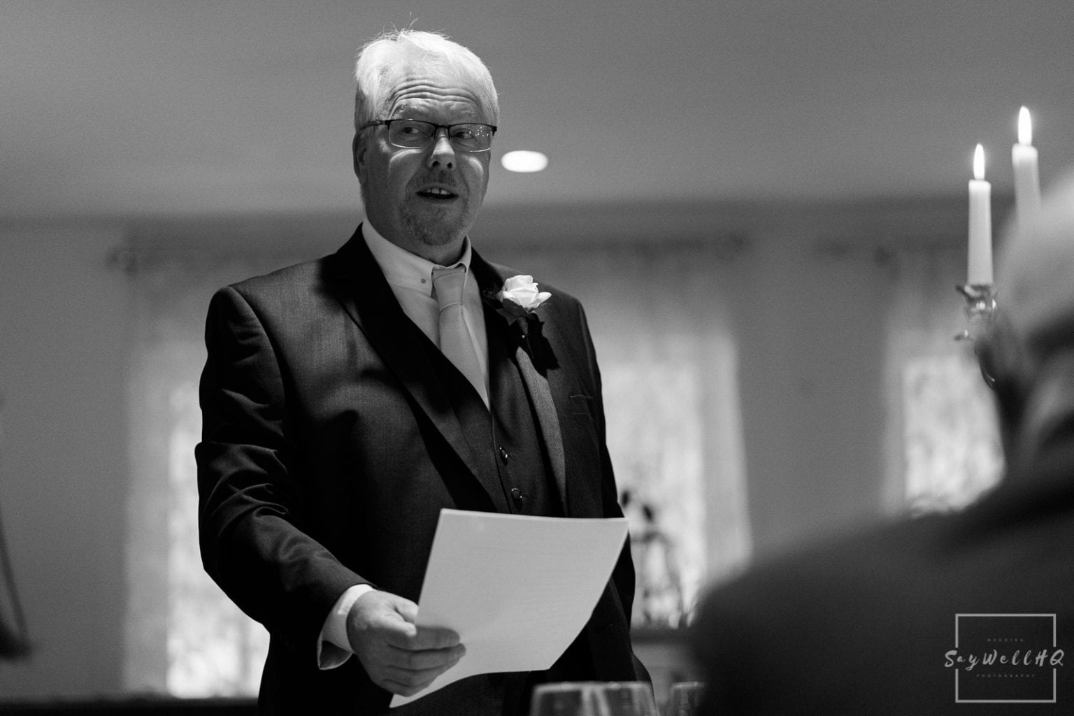 Woodborough Hall Wedding Photography + wedding guests enjoy the wedding speeches with the father of the bride and the best mans speeches