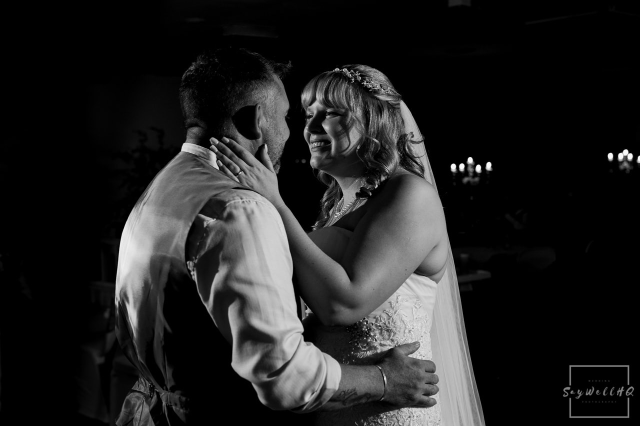 Woodborough Hall Wedding Photography + Bride and groom embrace during the wedding first dance