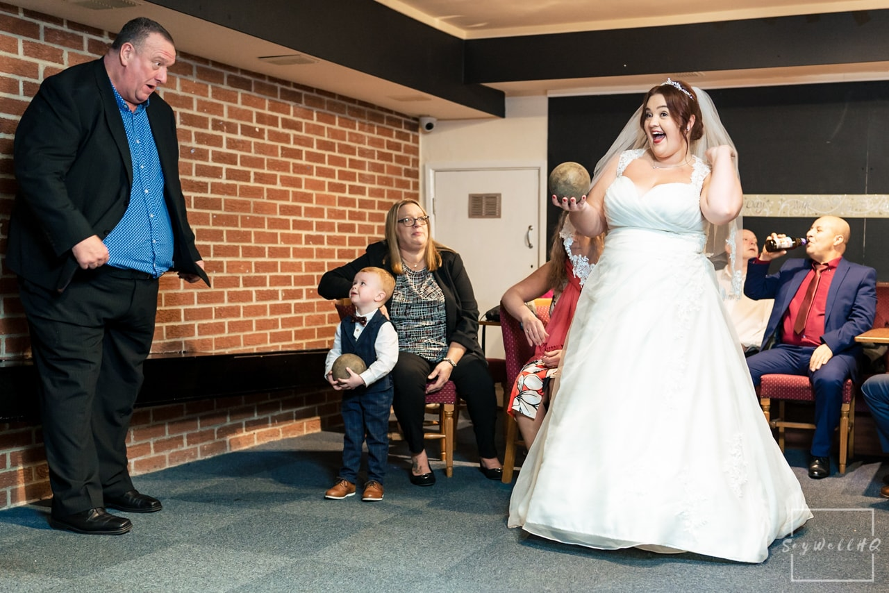 The Embankment Pub Nottingham Wedding Photography + Bride playing skittles after her wedding ceremony