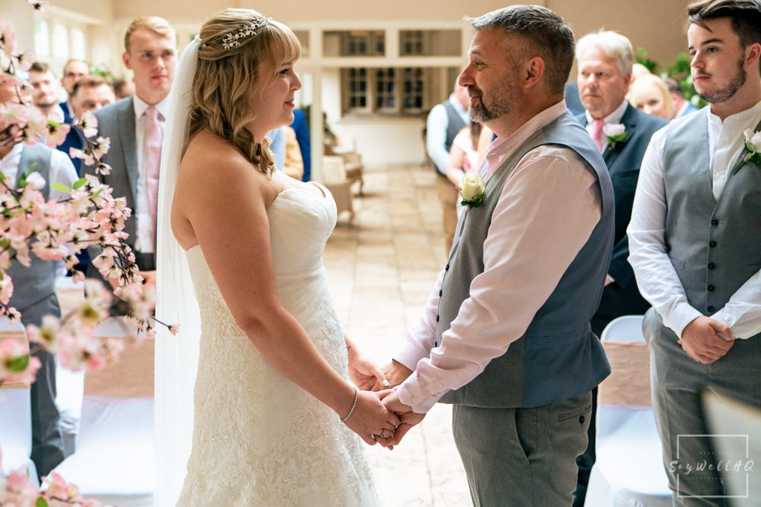 Woodborough Hall Wedding Photography + wedding ceremony bride and groom looking livingly at each other