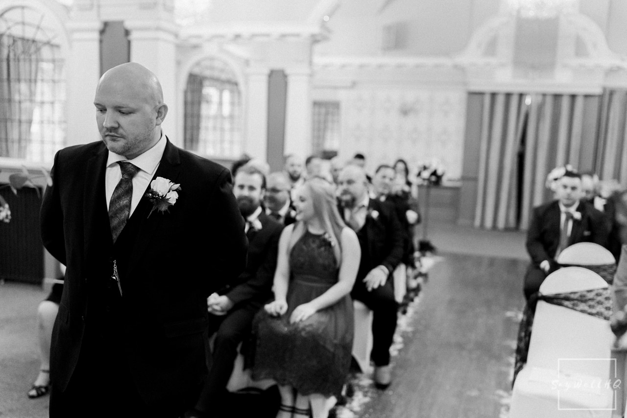 The Embankment Pub Nottingham Wedding Photography + Groom looking nervous waiting for his bride to walk down the aisle