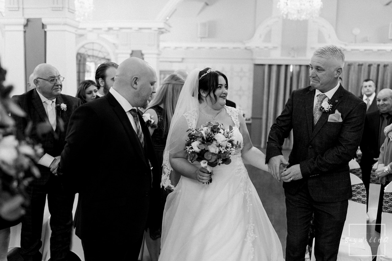 The Embankment Pub Nottingham Wedding Photography + Bride and Bridesmaids walking down the wedding aisle at the wedding venue Embankment Pub