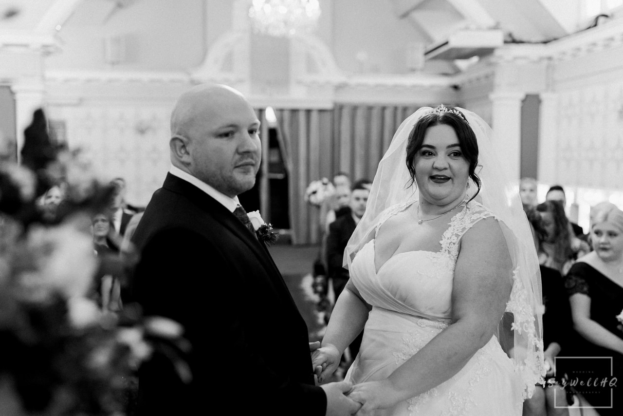 The Embankment Pub Nottingham Wedding Photography + Bride & Groom looking happy during their wedding ceremony