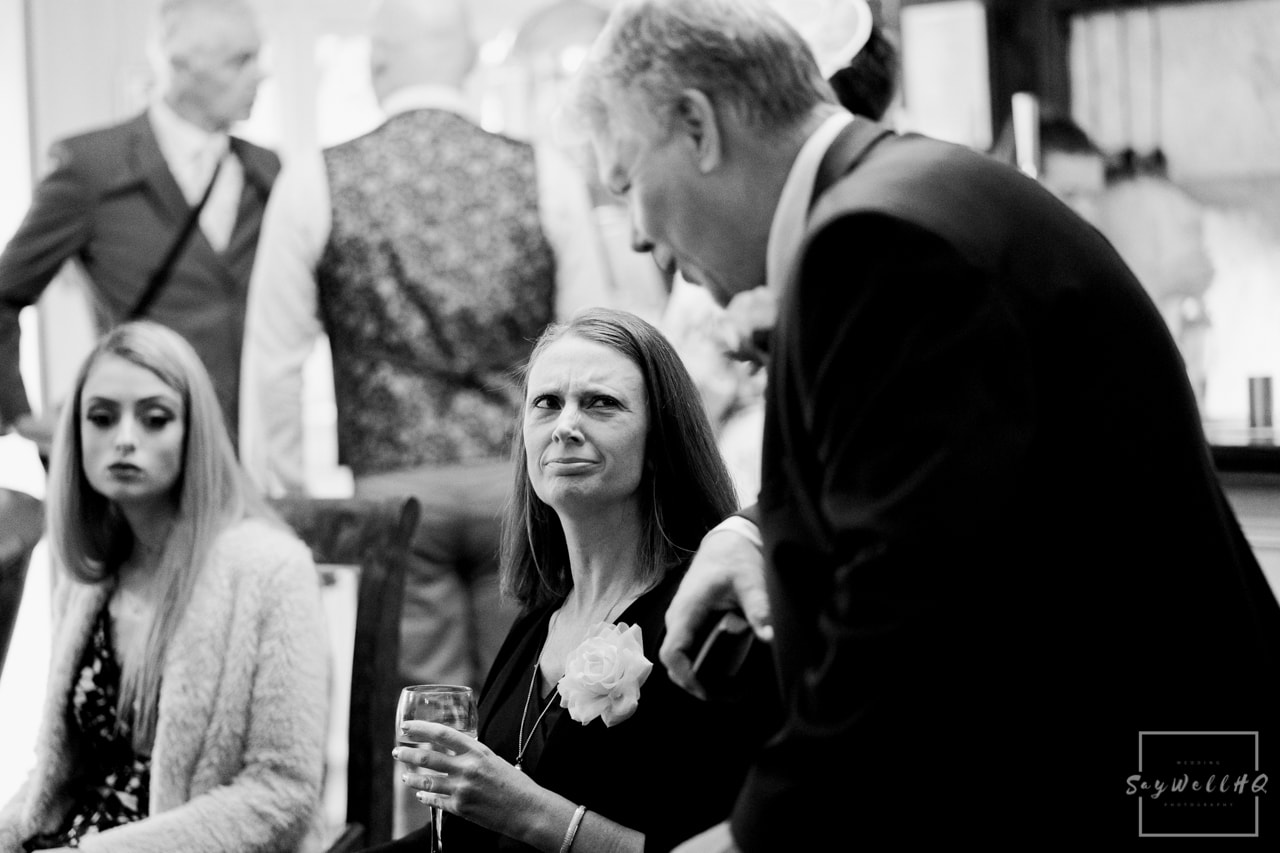 Woodborough Hall Wedding Photography + wedding guests arrive and hug and miss each other