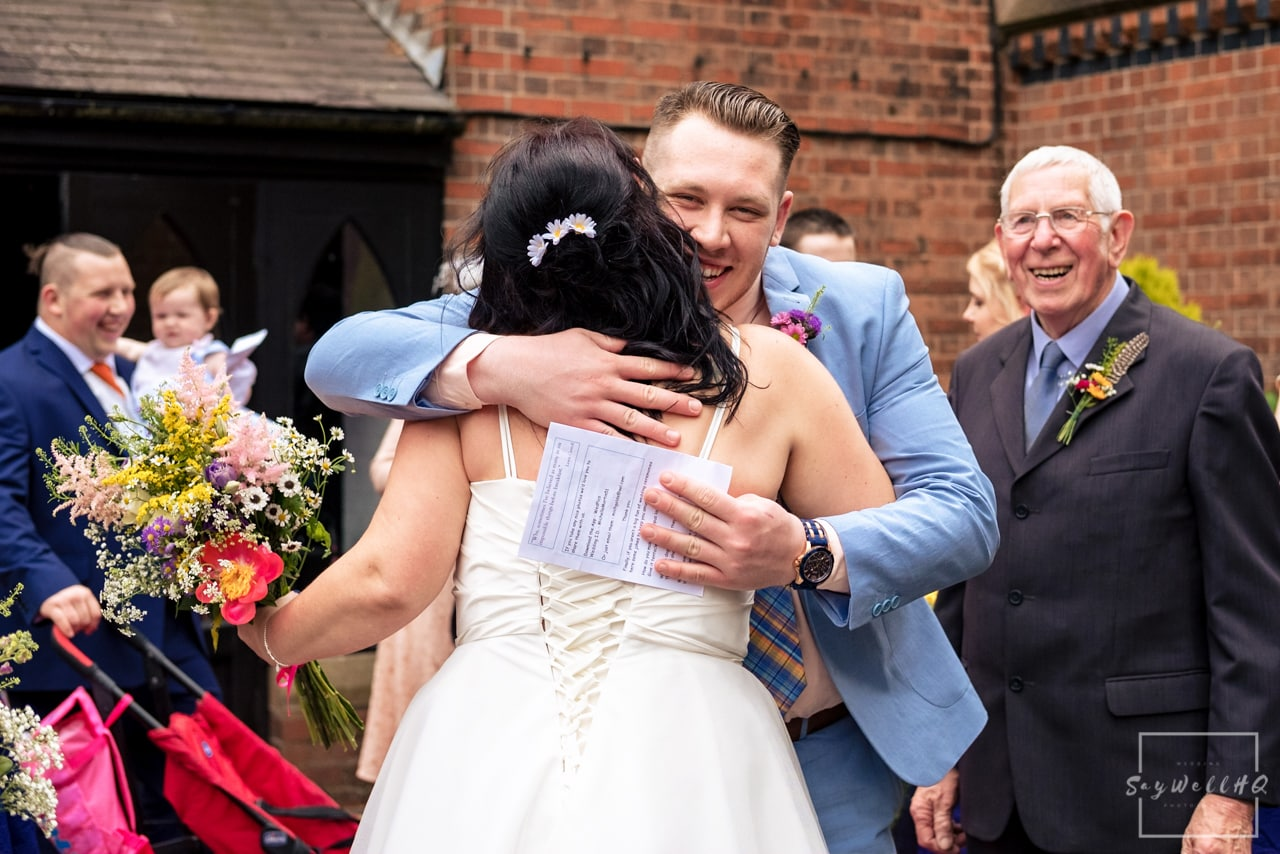 Relaxed Candid Wedding Photography + Bride and wedding guest hugs