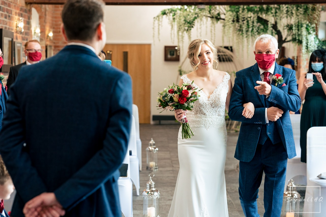 Relaxed Candid Wedding Photography + Bride walking down the aisle at her wedding