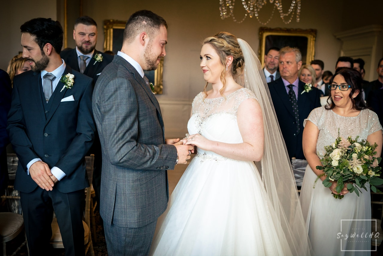 Nottingham wedding photographer - bride and groom looking at each other lovingly during the wedding ceremony