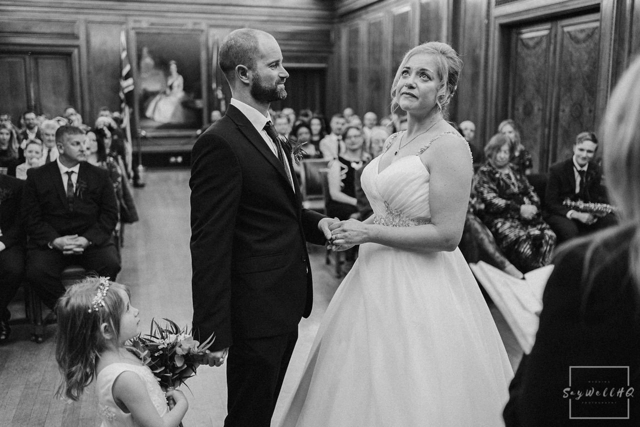 Nottingham council house wedding photographer + bride and groom looking at each other lovingly during the wedding ceremony