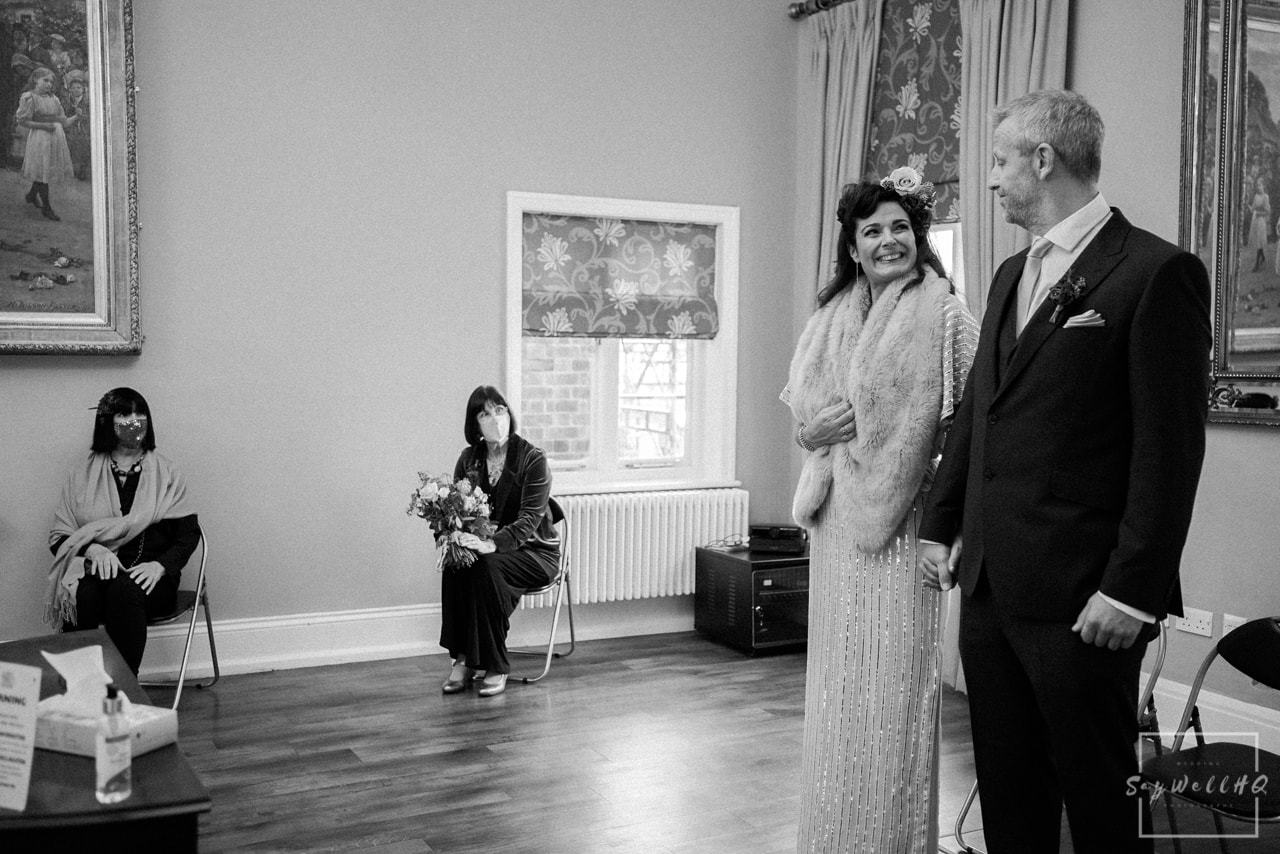 West Bridgford Hall wedding photographer + bride and groom looking at each other lovingly during the wedding ceremony
