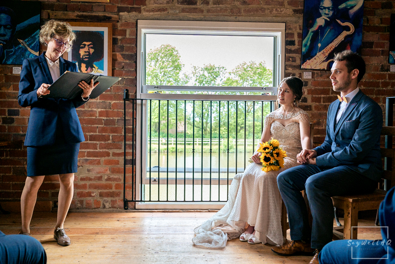 Leicester wedding photographer - bride and groom looking at each other lovingly during the wedding ceremony