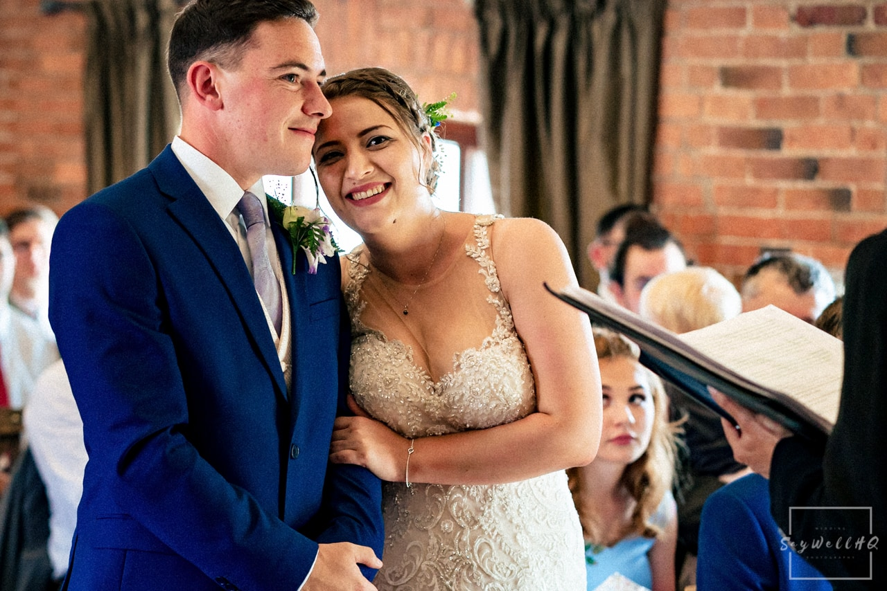 Swancar Farm wedding photographer + bride and groom looking at each other lovingly during the wedding ceremony