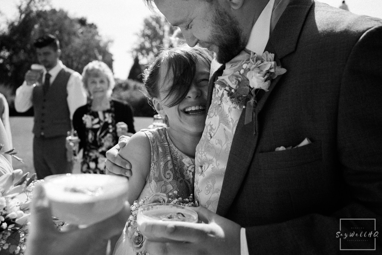 Nottingham Wedding Photography - Wedding Hugs between the bride + groom and wedding guests