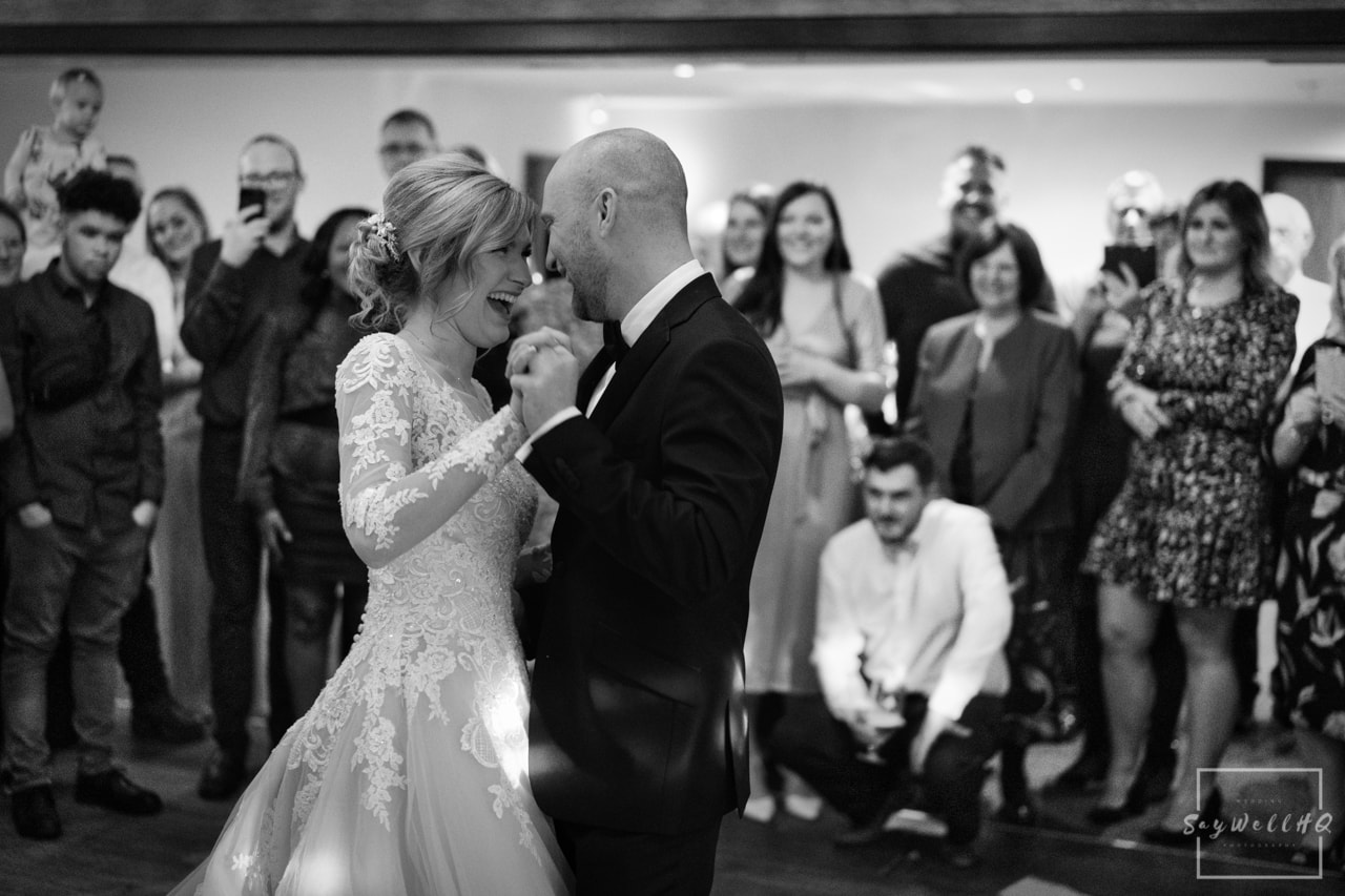 Nottingham Wedding Photography - Bride and groom dancing during the wedding first dance with their family and friends looking on