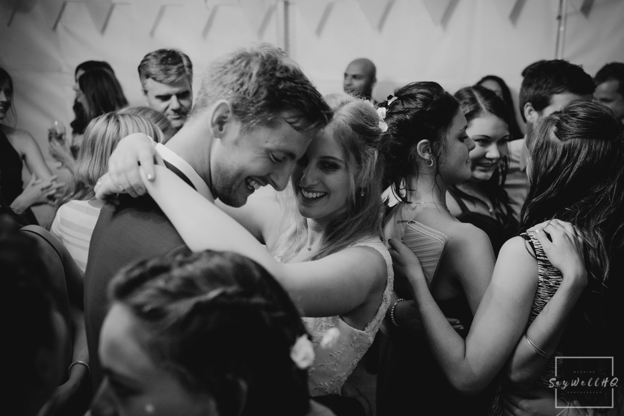 Nottingham Wedding Photography - Bride and groom dancing during the wedding first dance surrounded by their family and friends