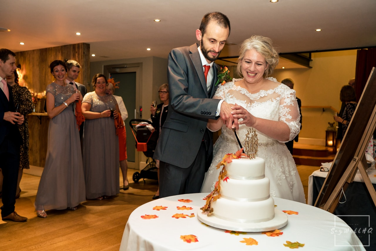 The Carriage Hall Wedding Photography + Carriage Hall Wedding Photographer + bride and groom cut the wedding cake on their wedding day
