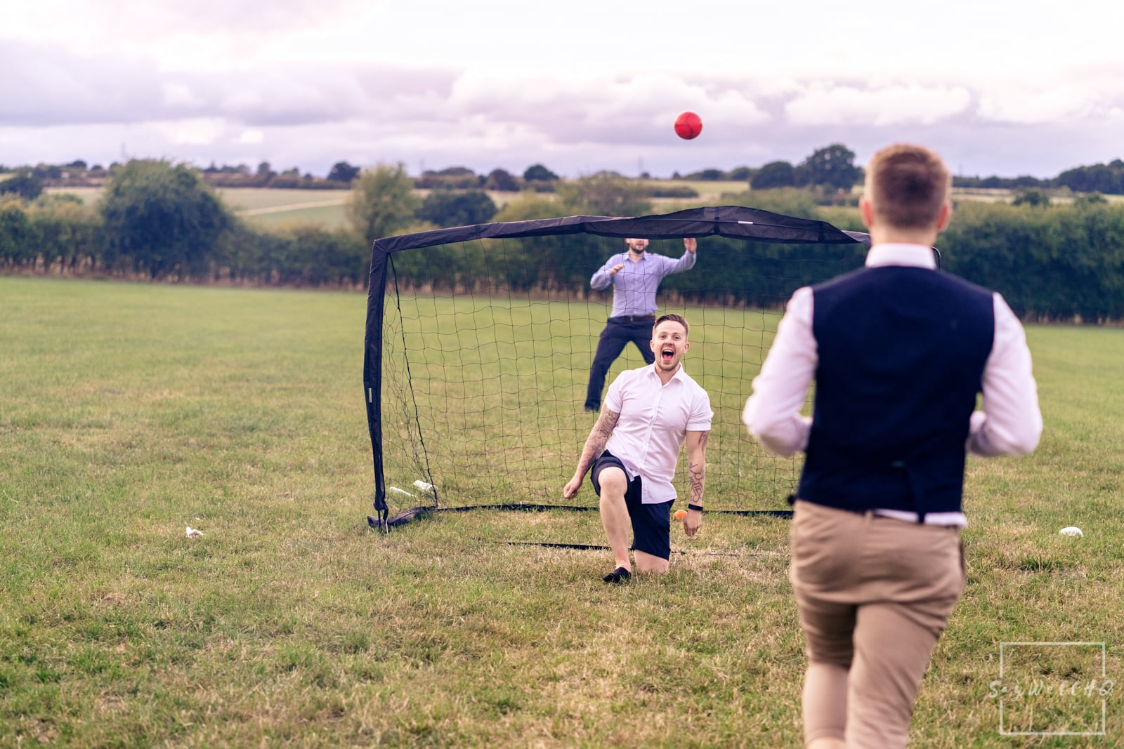 Mapperley Farm Wedding Photography + Mapperley Farm Wedding Photographer + wedding guests play summer games in the evening sunshine at a tipi wedding