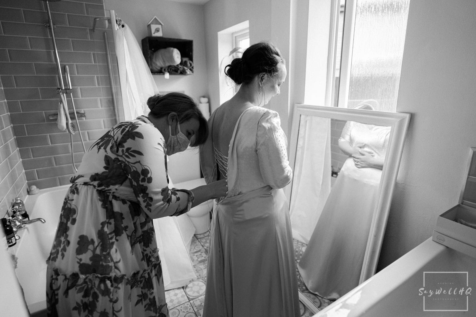 Newark Wedding Photography + Newark Wedding Photographer + bride having help getting into her wedding dress