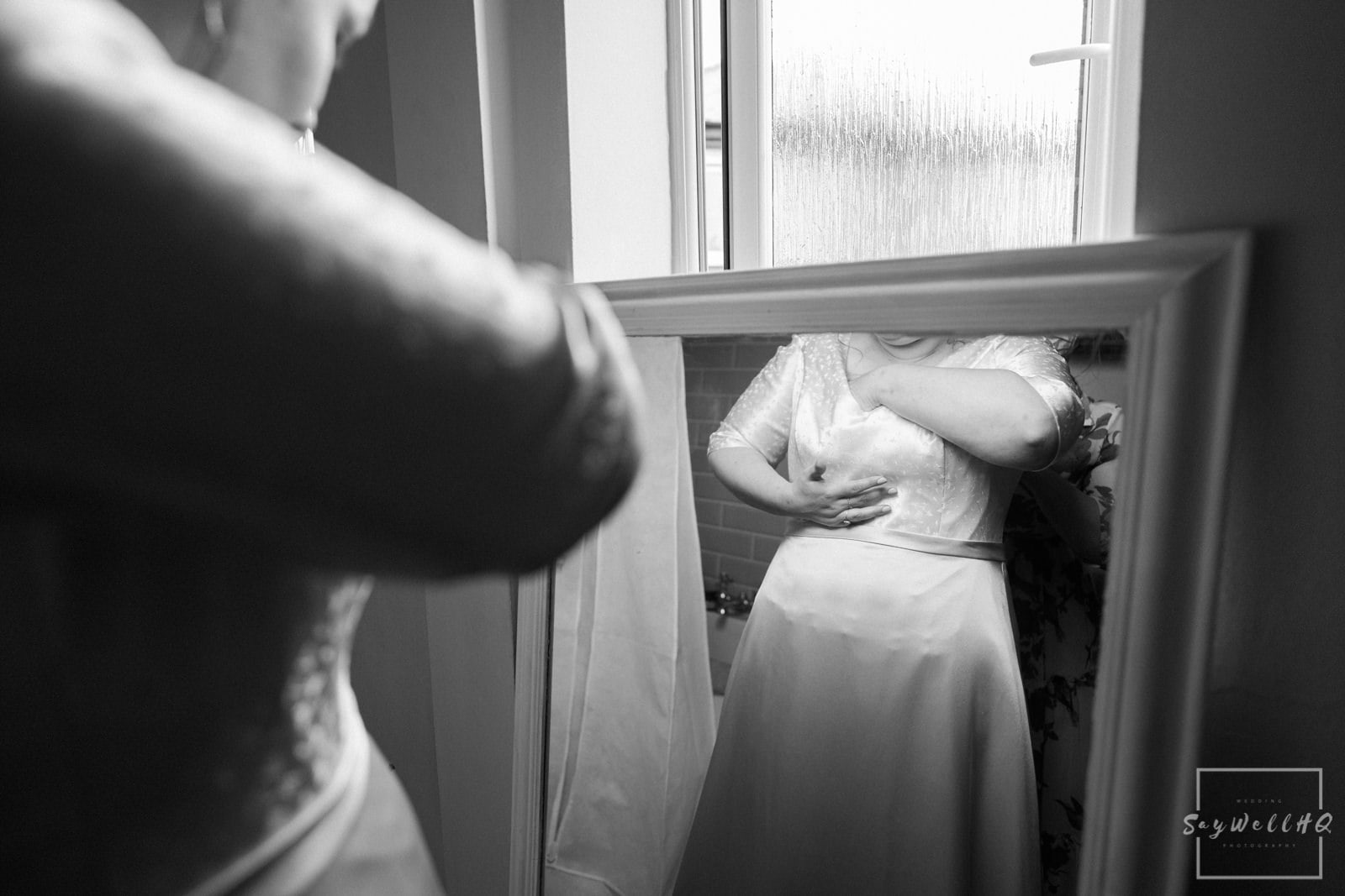 Newark Wedding Photography + Newark Wedding Photographer + bride adjusting herself in her wedding dress