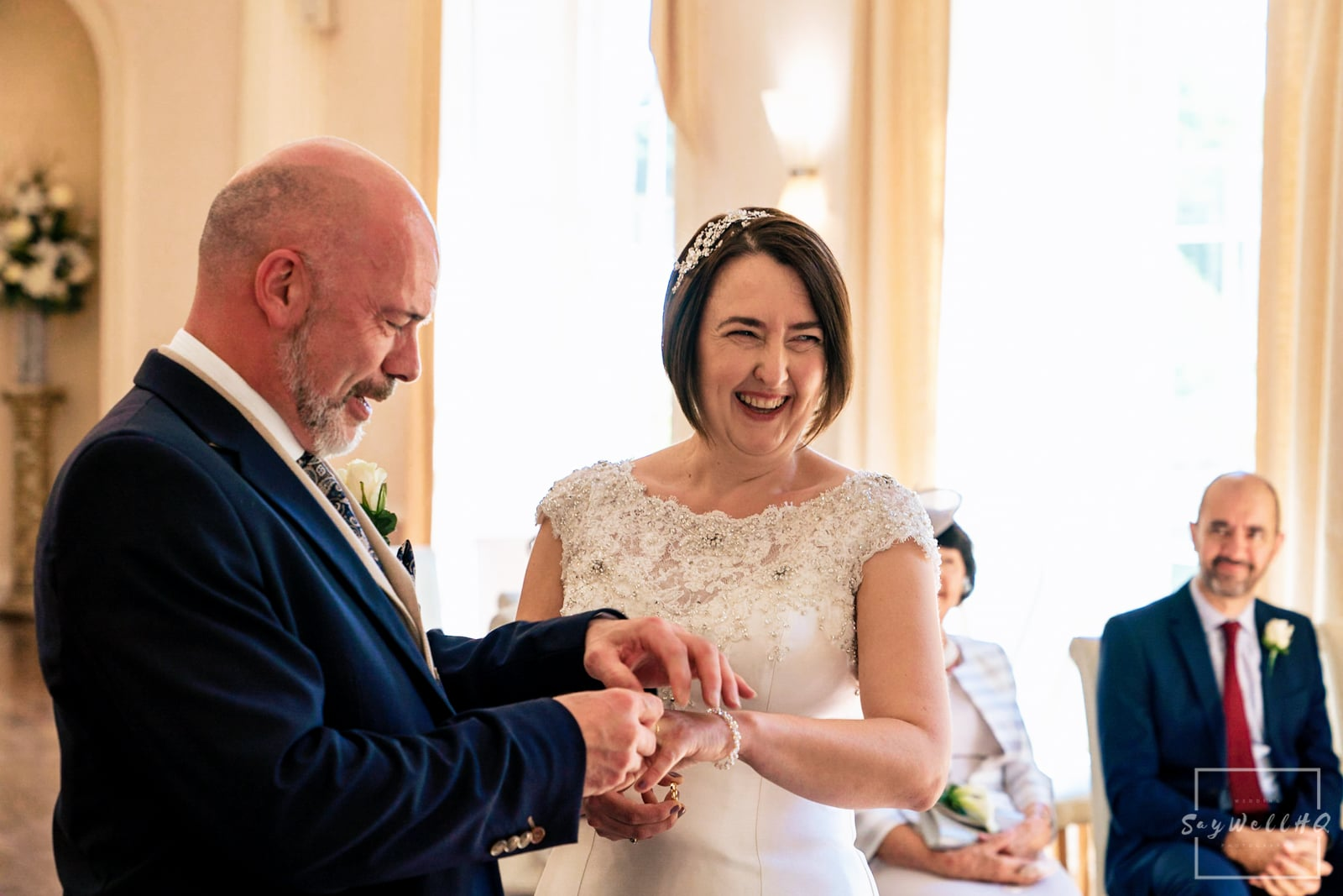 Colwick Hall Wedding Photography + Colwick Hall Wedding Photographer + bride and groom exchange wedding rings during their wedding ceremony at Colwick Hall