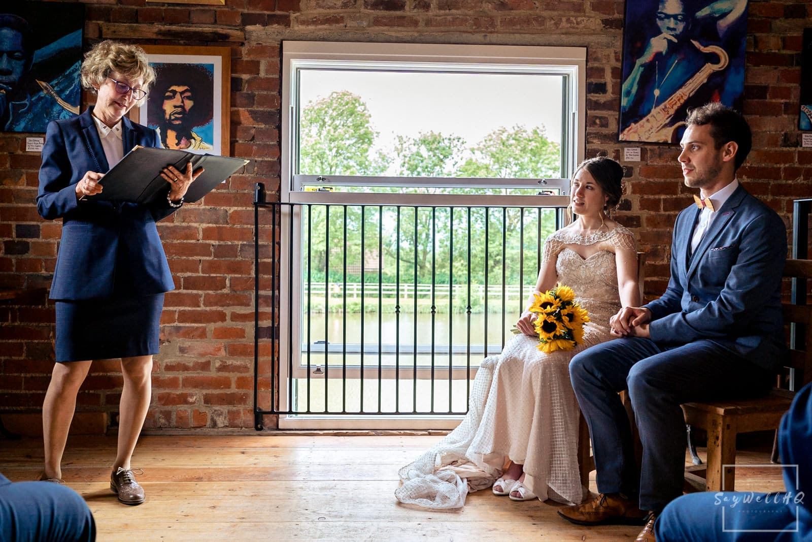 Leicester Wedding Photography + Leicester Wedding Photographer + Humanist Wedding Photographer + bride and groom watching on as the Humanist Celebrant conducts the Humanist wedding ceremony