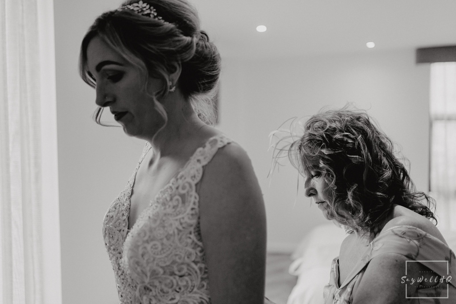 Goosedale Wedding Photography + Goosedale Wedding Photographer + Bride getting help from her Mum in getting in her wedding dress on the morning of her wedding