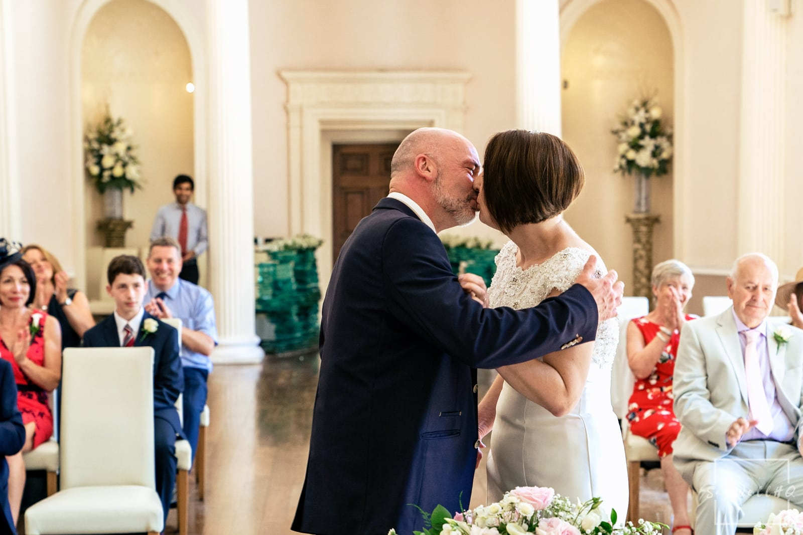 Colwick Hall Wedding Photography + Colwick Hall Wedding Photographer + bride and groom first kiss during their wedding ceremony at Colwick Hall