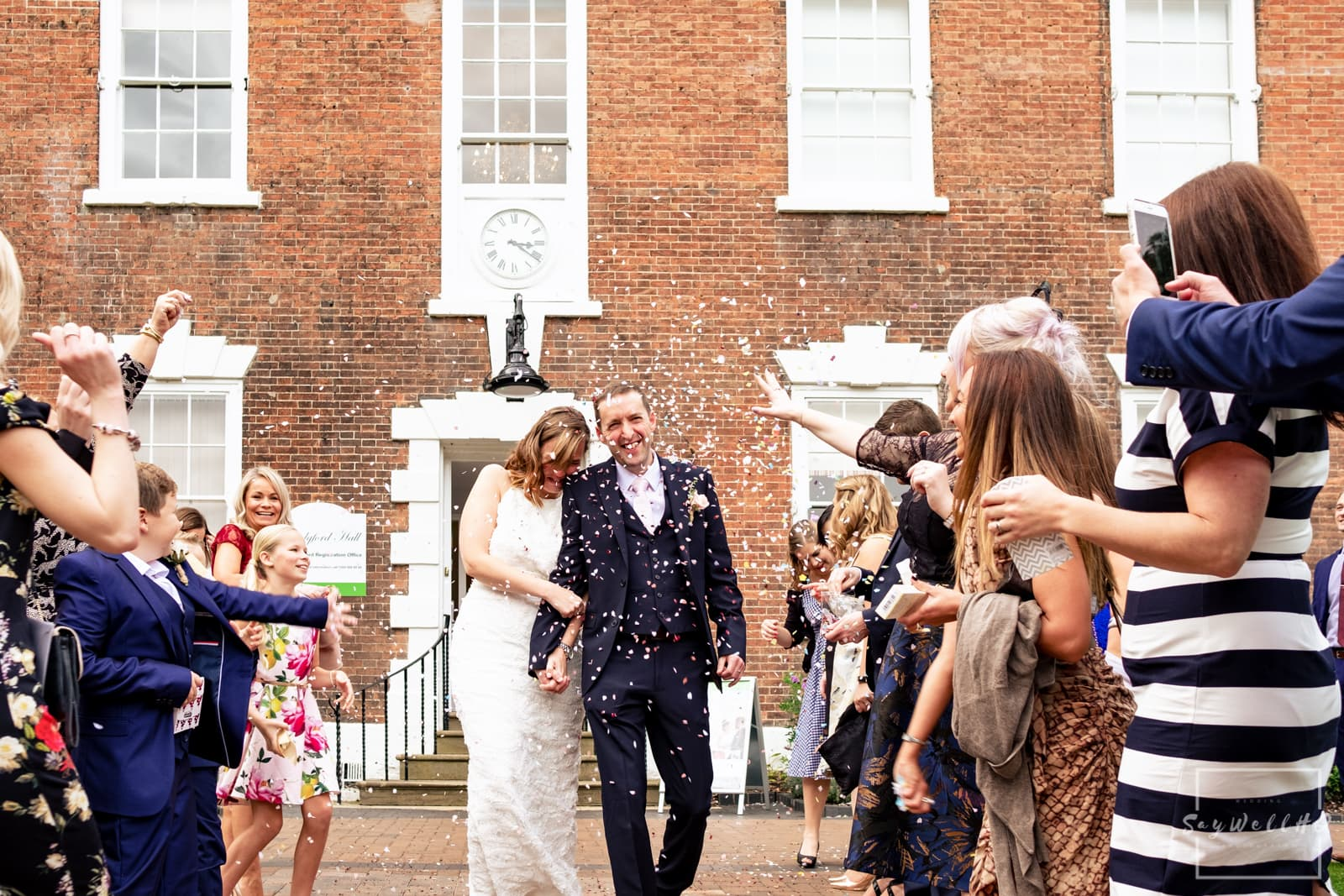 West Bridgford Wedding Photography + Bridgford Hall Wedding Photographer + bride and groom get covered in confetti after their wedding ceremony