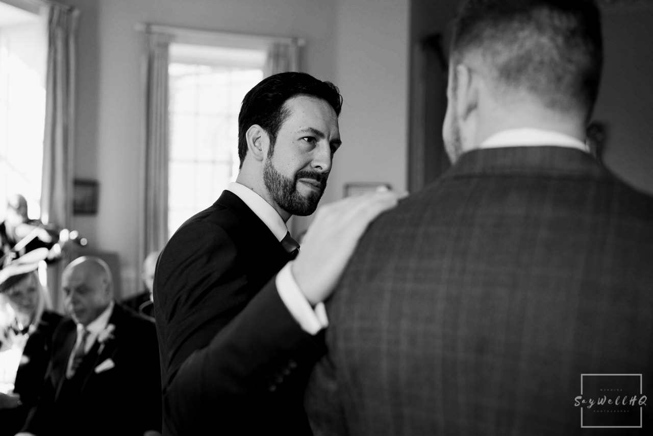 Norwood Park Wedding Photography + best man offers a gentle hand to the nervous groom