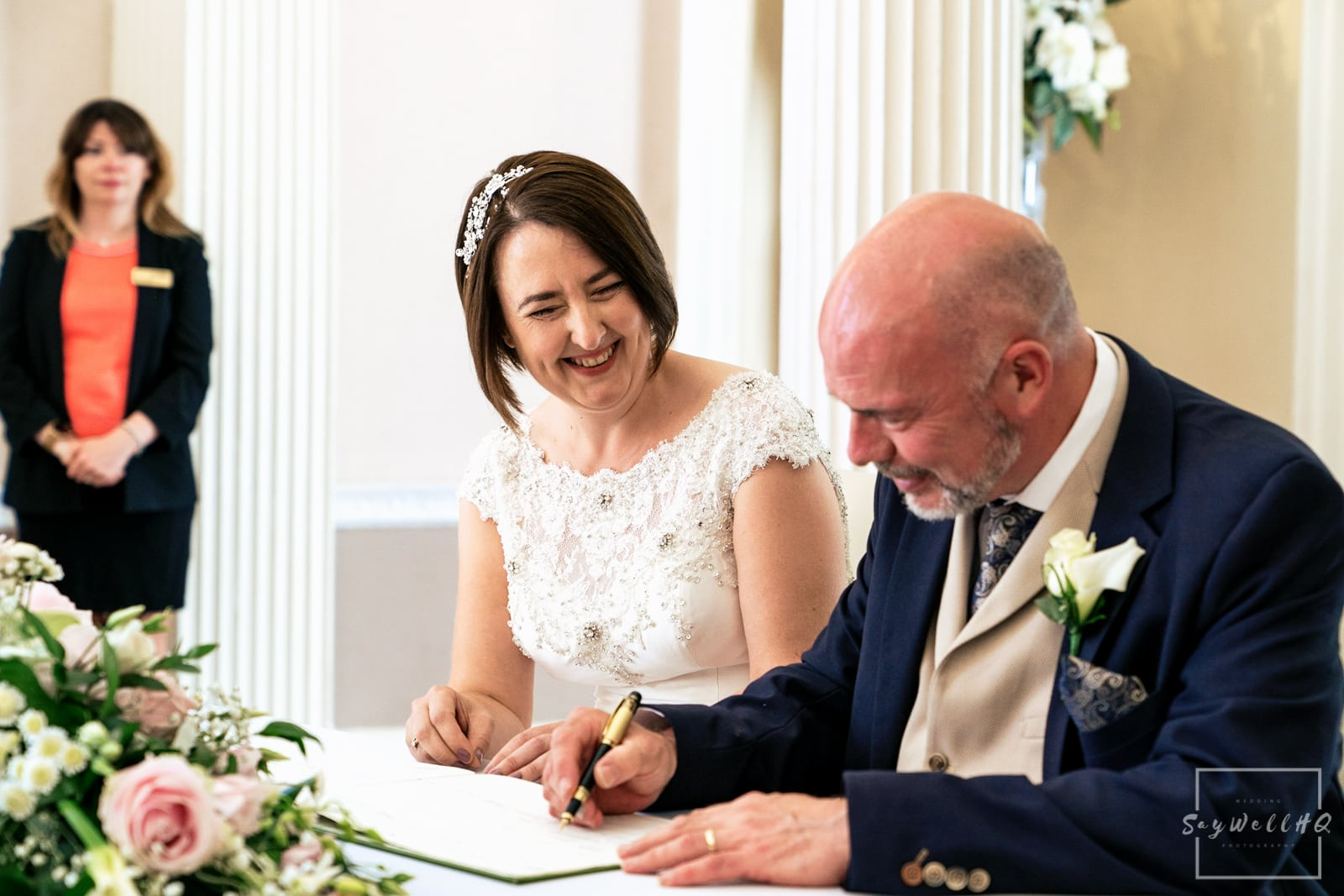 Colwick Hall Wedding Photography + Colwick Hall Wedding Photographer + bride and groom sign the wedding register during their wedding ceremony at Colwick Hall
