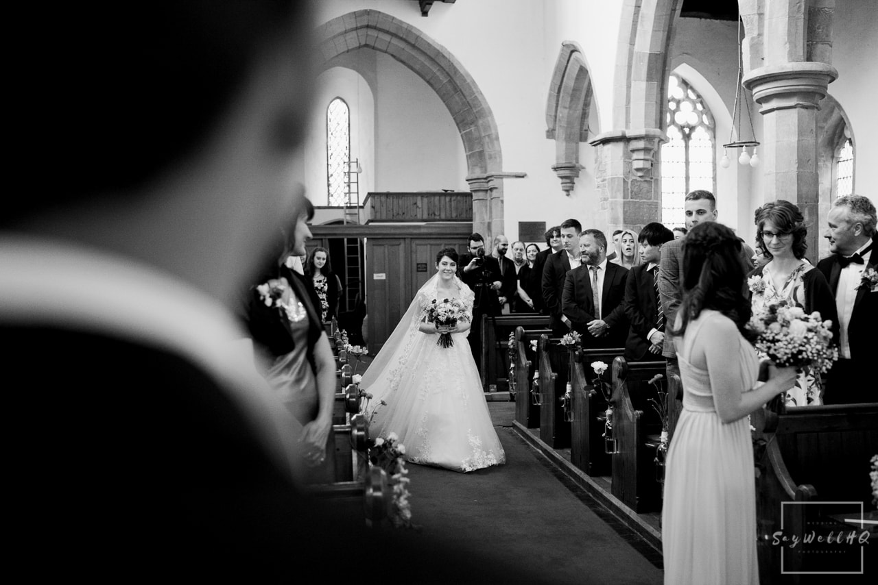 Southwell Wedding Photography + Newark Wedding Photographer + Church Wedding Photographer + bride walking down the aisle in a Church in Nottingham