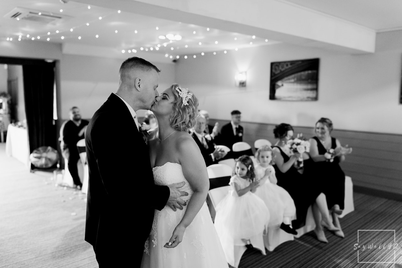 Brewhouse and Kitchen Wedding Photography + The Riverside Gallery Wedding Photographer  + bride and groom first kiss during their wedding ceremony