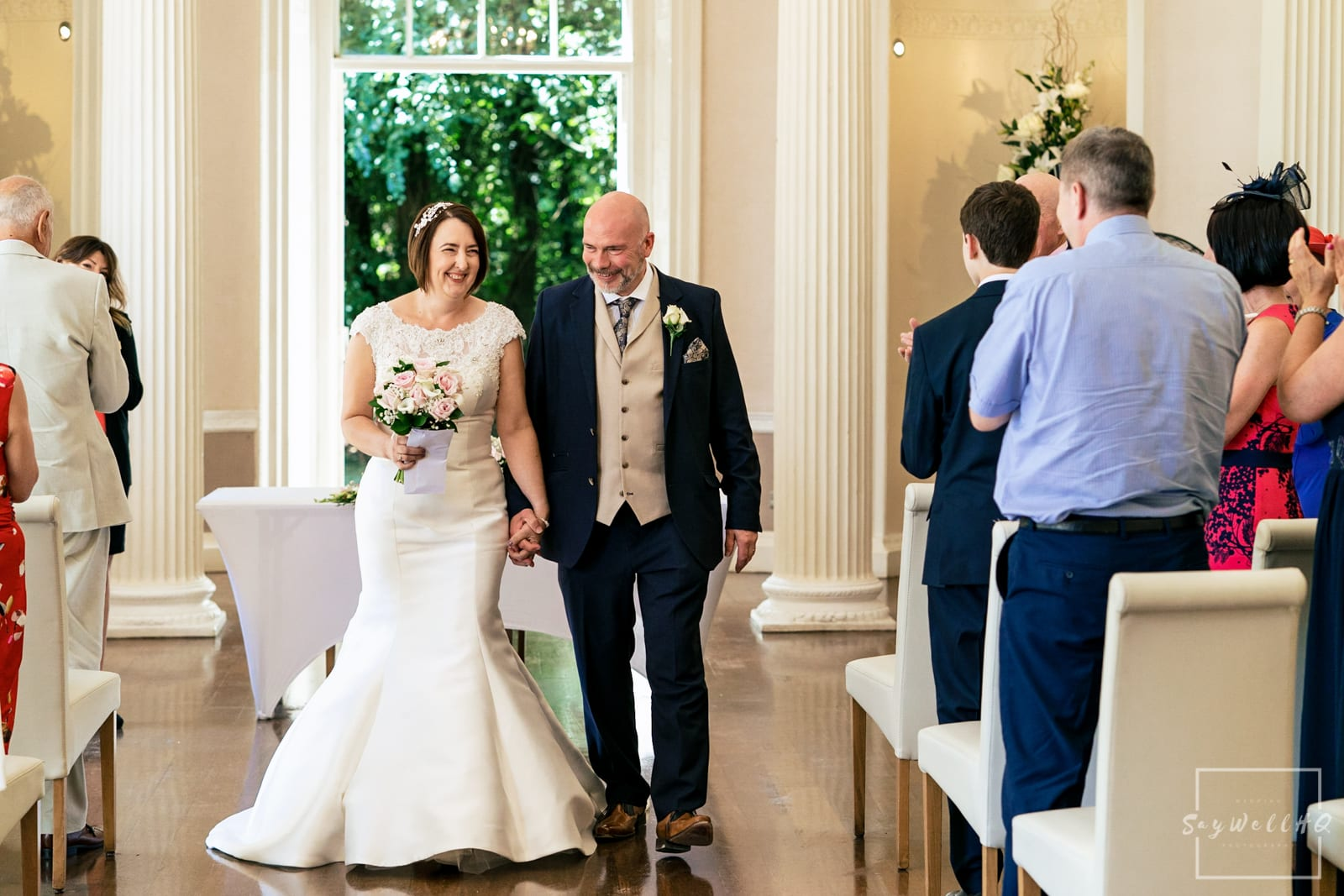 Colwick Hall Wedding Photography + Colwick Hall Wedding Photographer + bride and groom walking back down the aisle after their wedding ceremony at Colwick Hall Hotel
