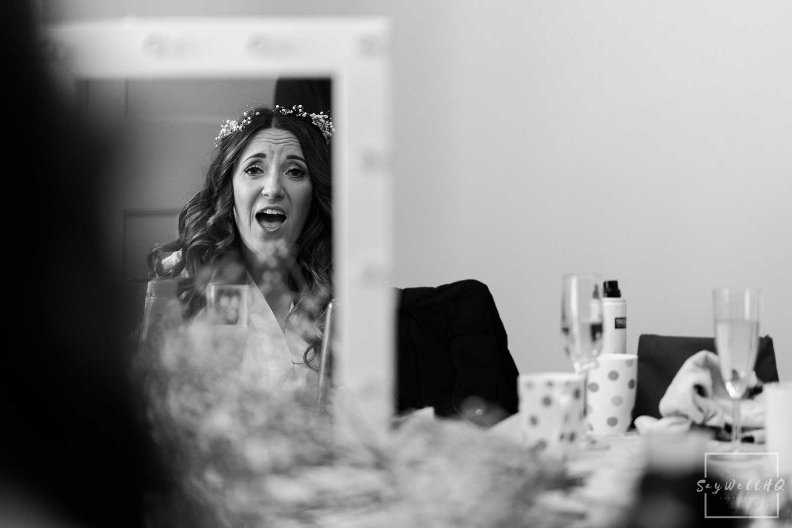 bride getting excited after her make-up is done on the morning of her wedding at mapperley farm