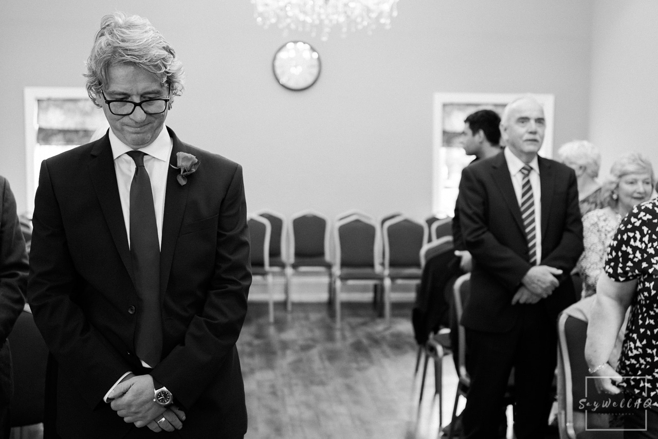 West Bridgford Hall Wedding Photography + Bridgford Hall Wedding Photographer + groom looking nervous waiting for the bride to arive