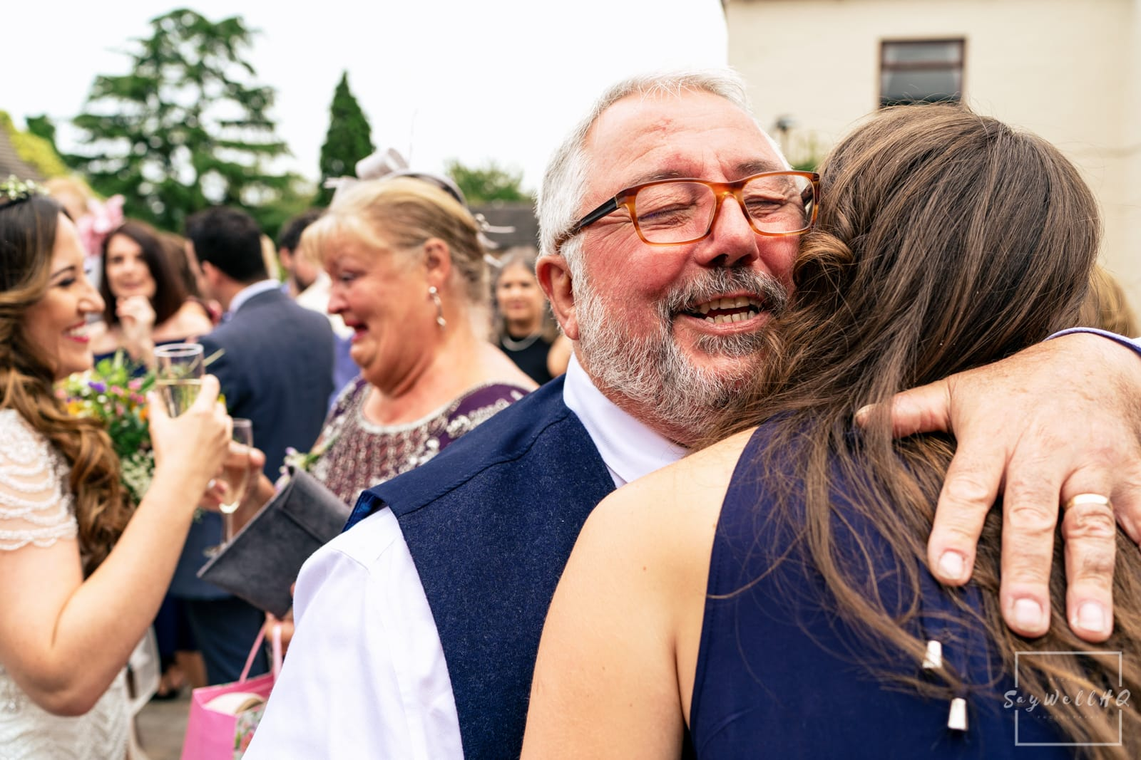 Mapperley Farm Wedding Photography + Mapperley Farm Wedding Photographer + wedding guests celebrate in the courtyard after the wedding ceremony in a converted barn