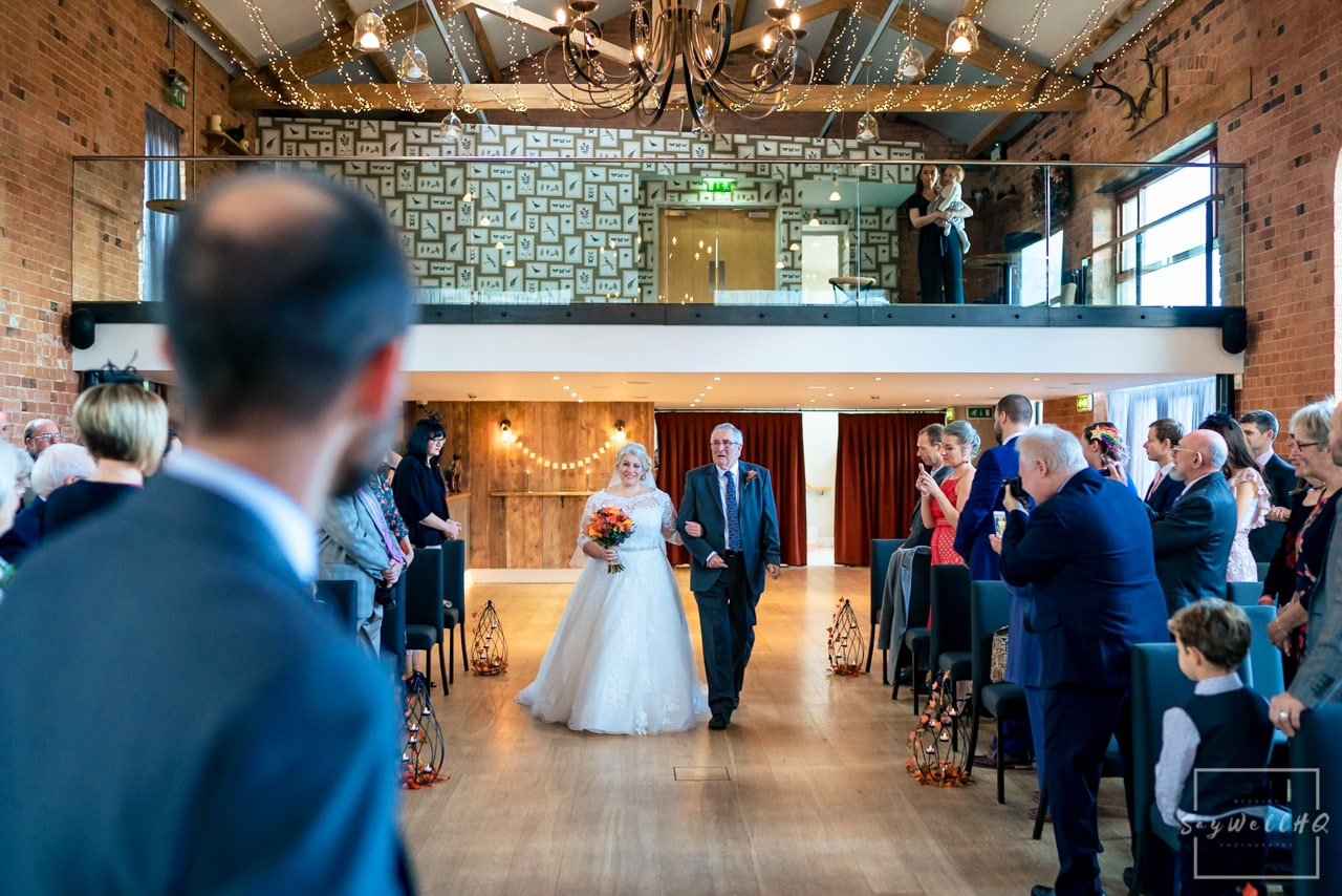 The Carriage Hall Wedding Photography + Carriage Hall Wedding Photographer + Bride walking down the aisle at the Carriage hall with her father