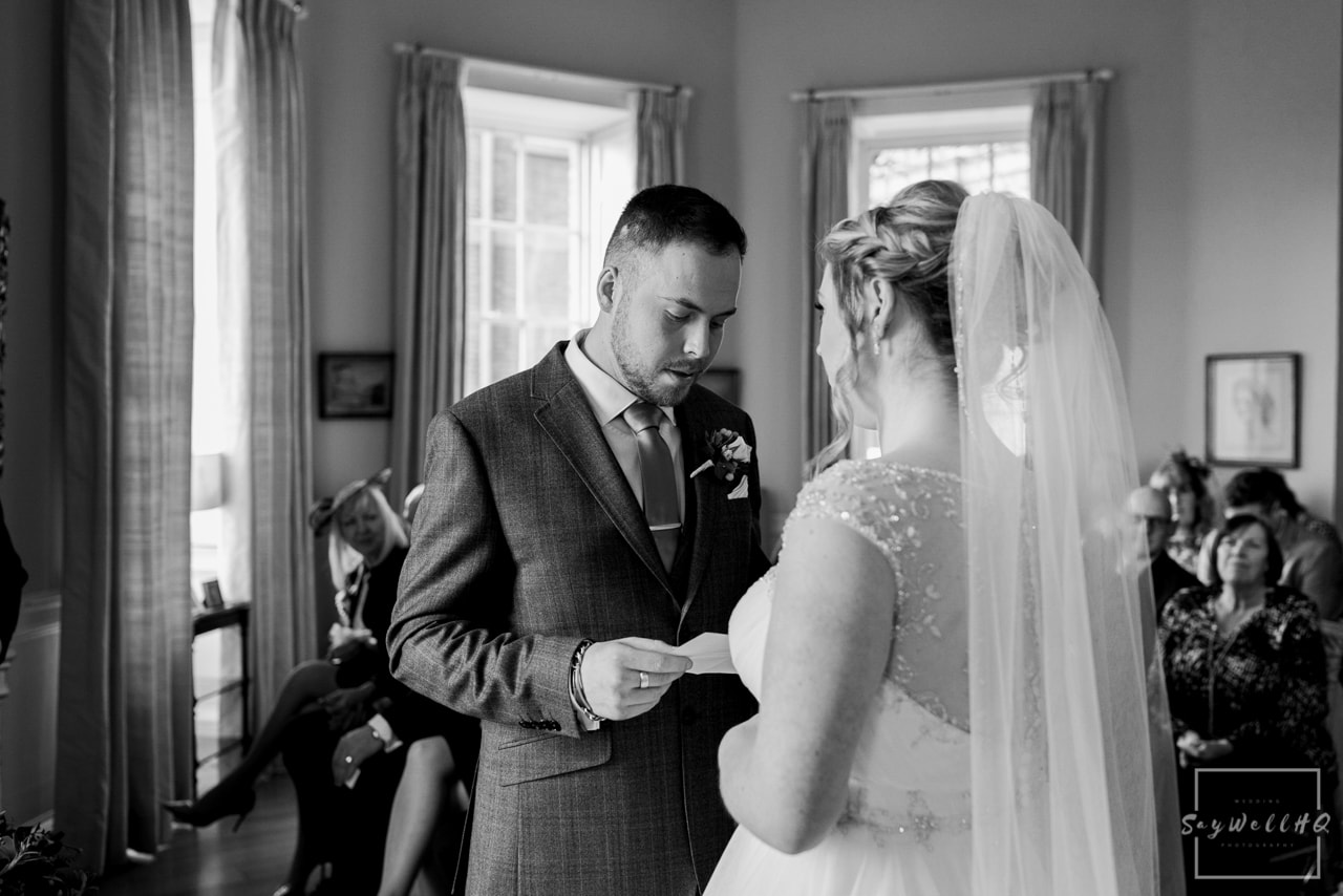Norwood Park Wedding Photography + bride and groom exchange vows during their Norwood Park Wedding Ceremony